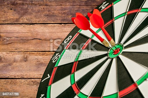 istock Two Darts in the center of the target dartboard 940147786