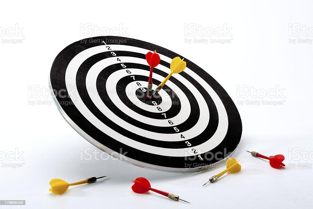 Two darts on abullseye royalty-free stock photo