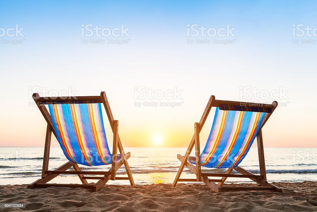 ... Two Deck Chairs On A Sandy Beach At Sunset Stock Photo ...