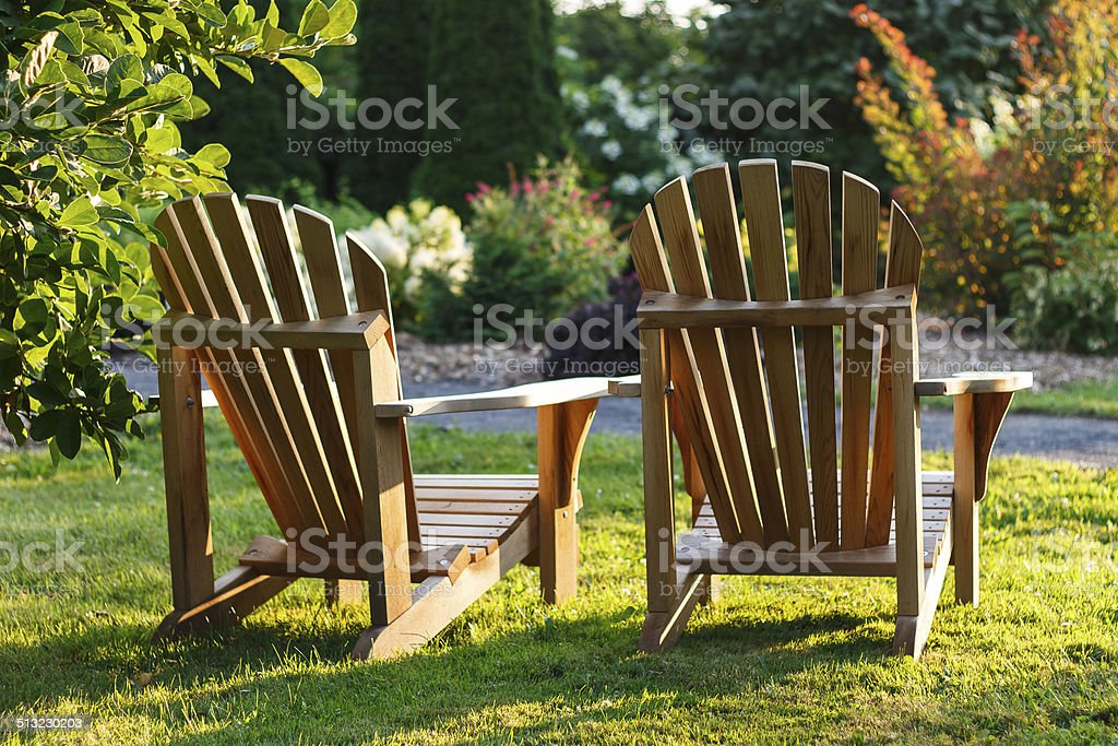 Two deck chairs overlooking a garden stock photo