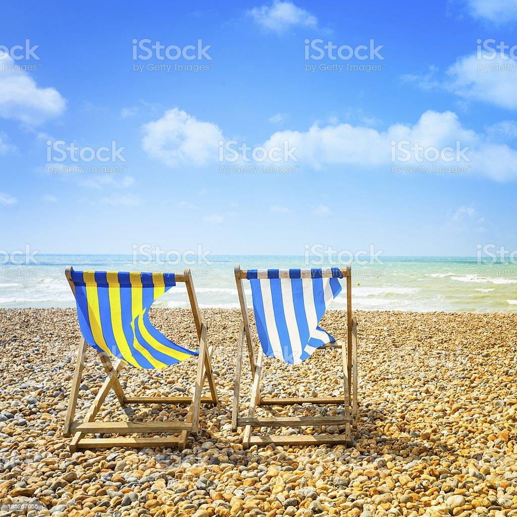 Two Deckchair in Brighton Beach at Summer stock photo