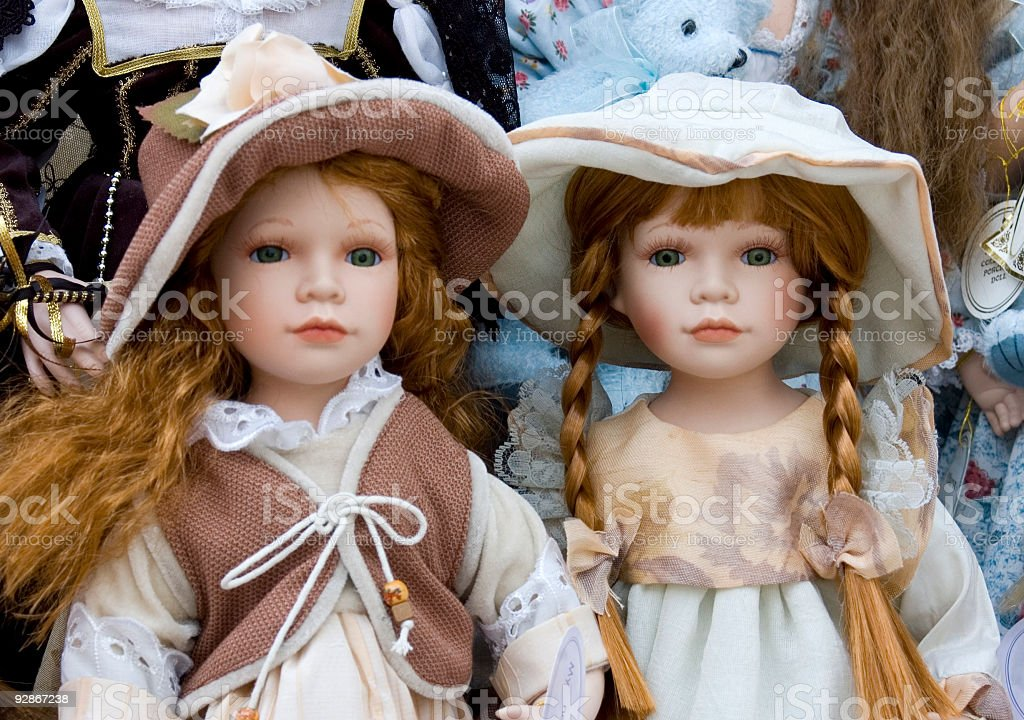 Two delicate dolls in traditional clothes with red hair stock photo