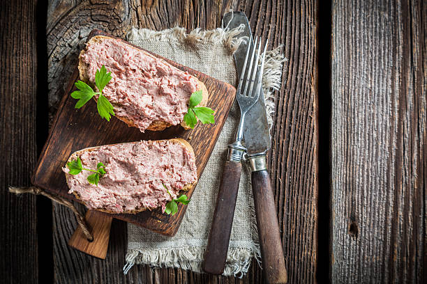 Two delicious sandwich made of pate with parsley stock photo