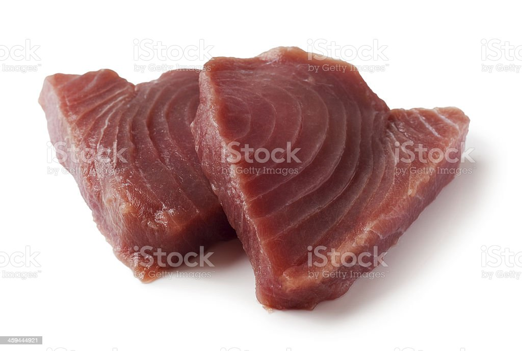 Two delicious tuna fish steak isolated on a white background stock photo