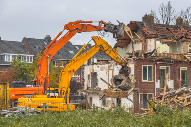 Two Demolition cranes at work stock photo
