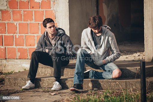 istock Two depressed and sad young buddies friends thinking about problems 680510986