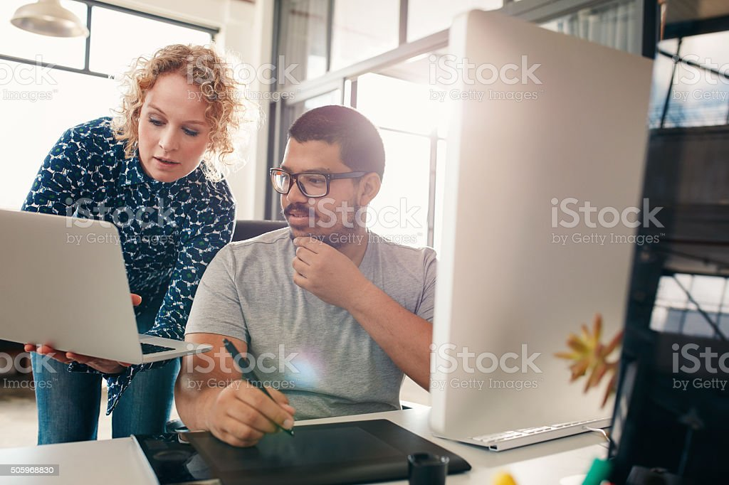 Two designers working in their office stock photo
