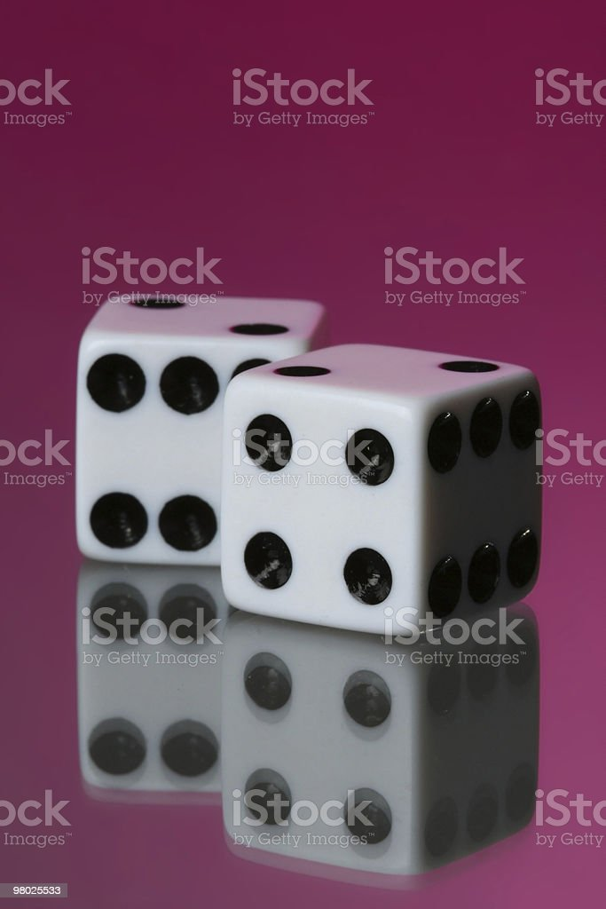 Two Dice Against Pink royalty-free stock photo
