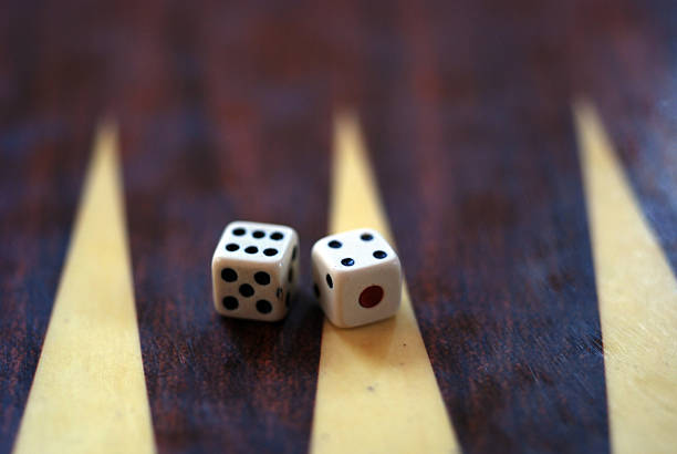 two dice setup on backgammon board stock photo