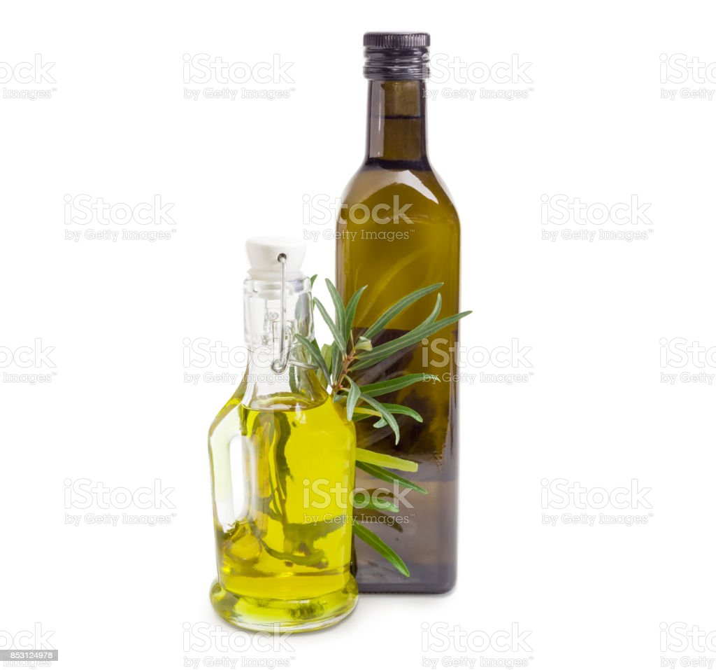 Two different bottles of olive oil with olive branch stock photo