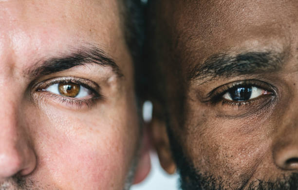 two different ethnic men's eyes closeup - eye stock pictures, royalty-free photos & images