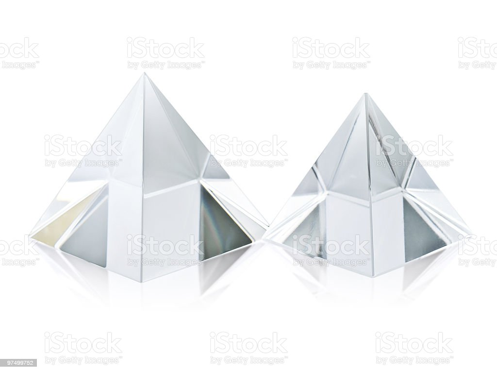 Two different size clear transparent crystal pyramids on white stock photo