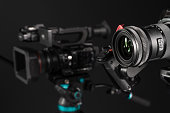 Two different types of professional video cinema broadcast camera on black background. The picture is taken with Sony A7III camera.