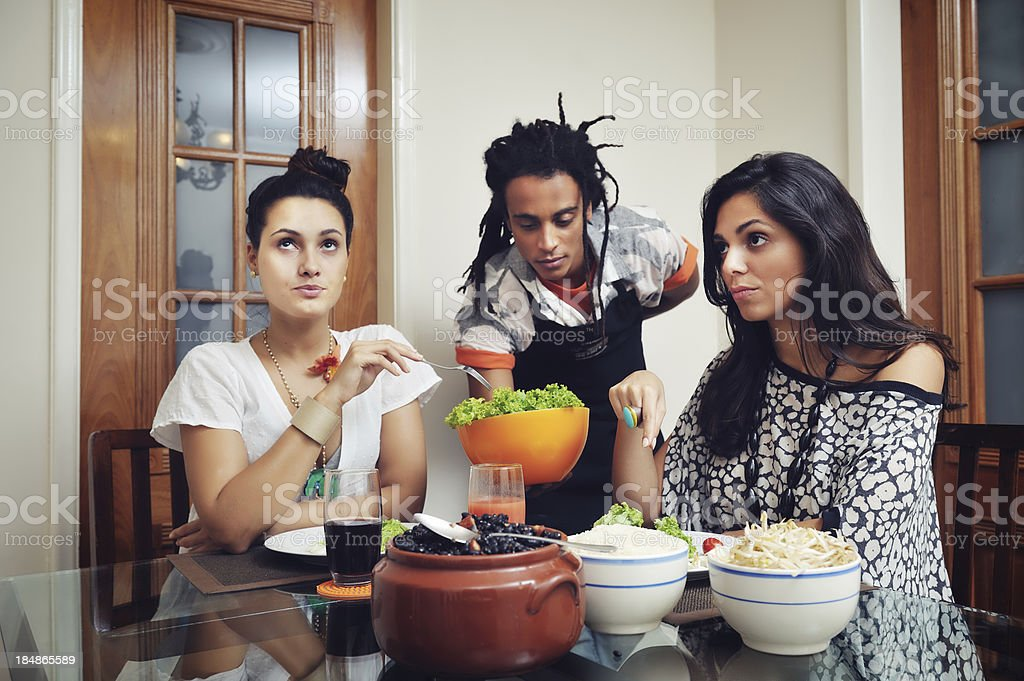 Two Divas Displeased with their male friend bringing food. royalty-free stock photo