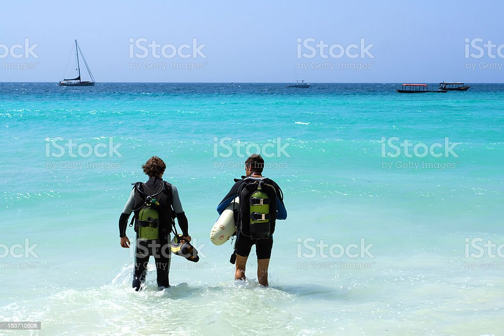 two divers standing up to their knees in water stock photo