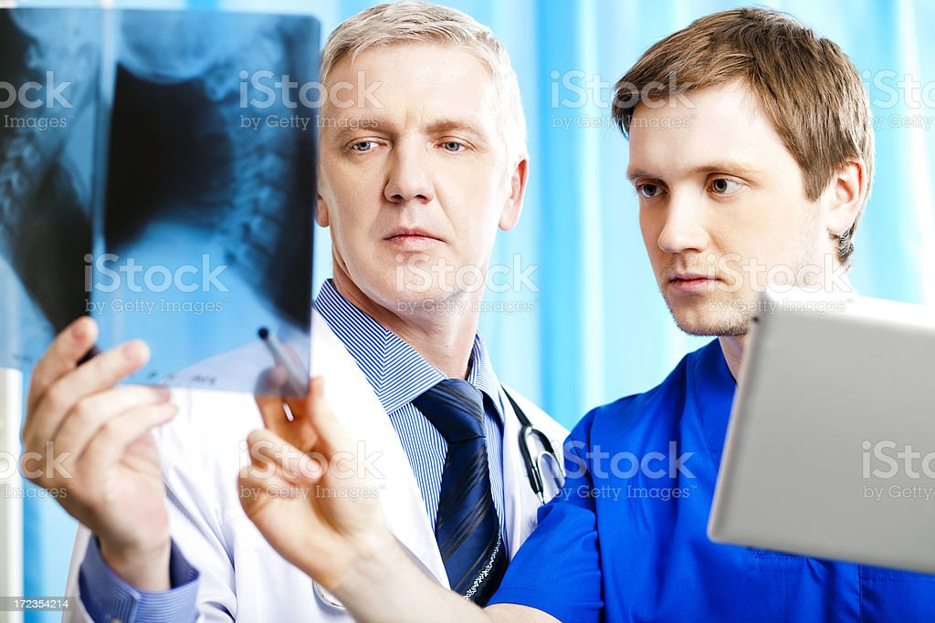 Two doctors looking at the x-ray image royalty-free stock photo