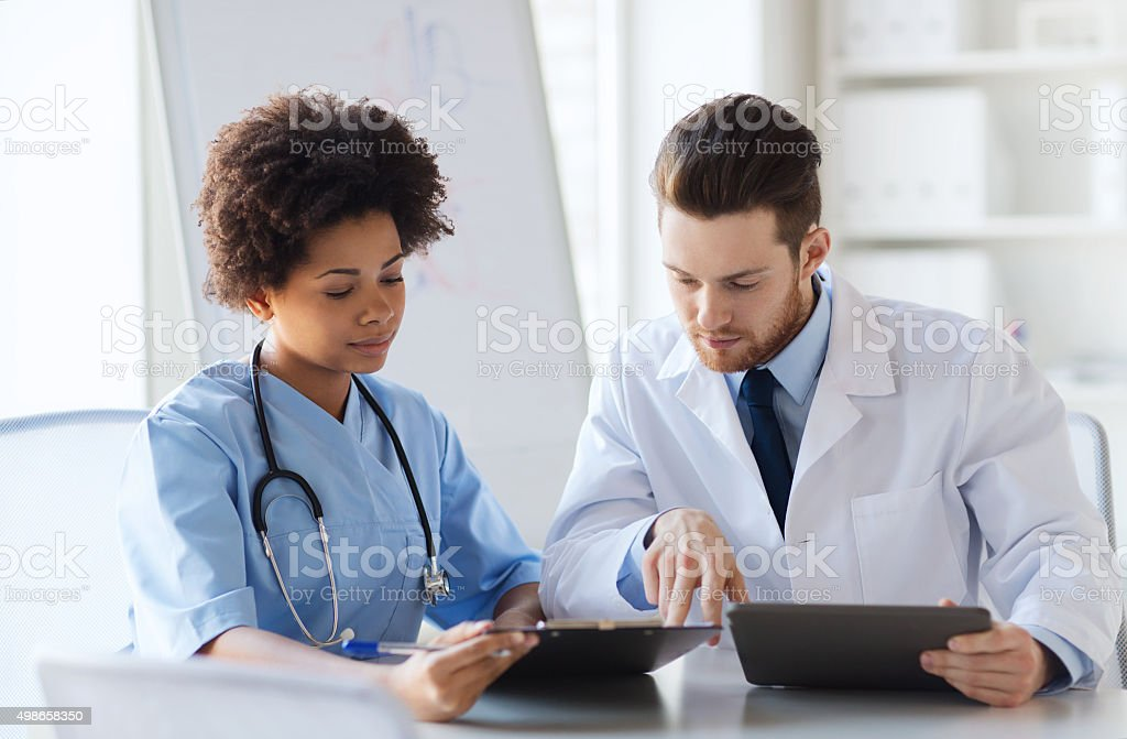 two doctors meeting at hospital office stock photo