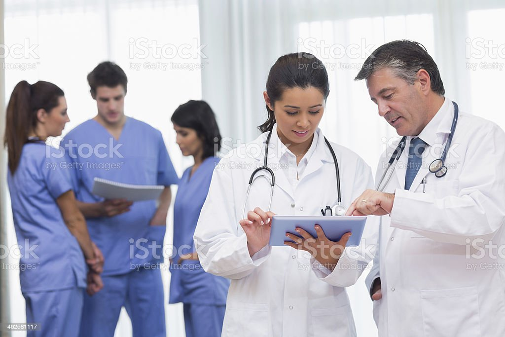 Two doctors reading book royalty-free stock photo
