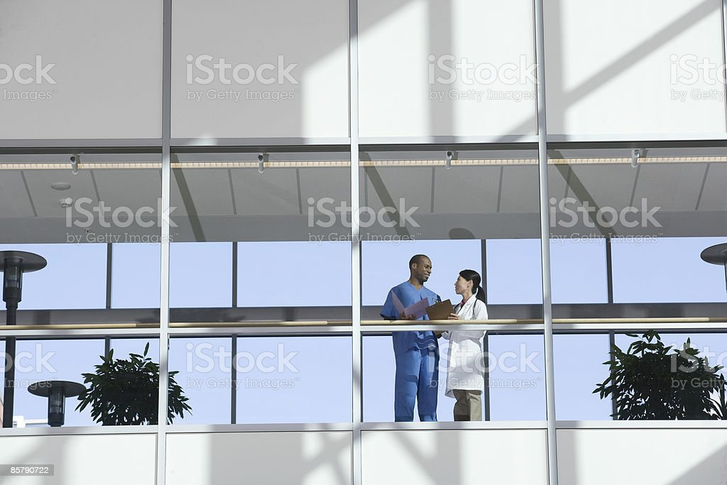 Two Doctors Talking in Corridor royalty-free stock photo