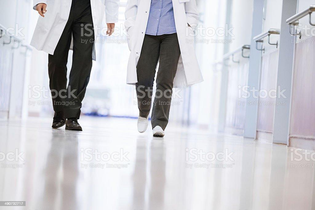 Two Doctors Walking A Corridor stock photo