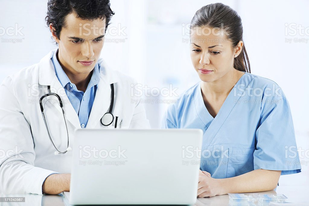 Two doctors working together on a laptop. royalty-free stock photo
