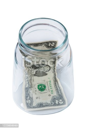 two dollar bill in a glass jar. concept of savings and accumulation of money
