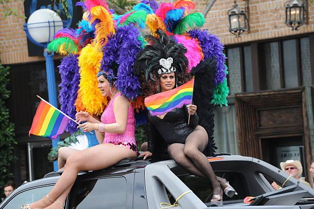 two drag queens ride along in gay pride parade - drag queen stockfoto's en -beelden