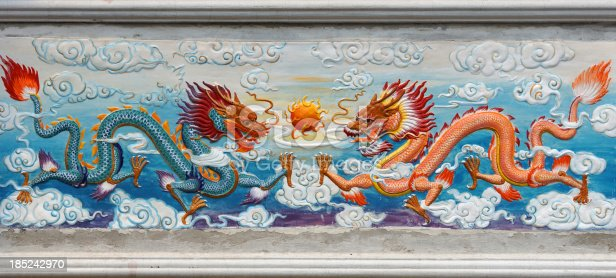 istock Two Dragon and fire ball painted image at Chinese Temple 185242970