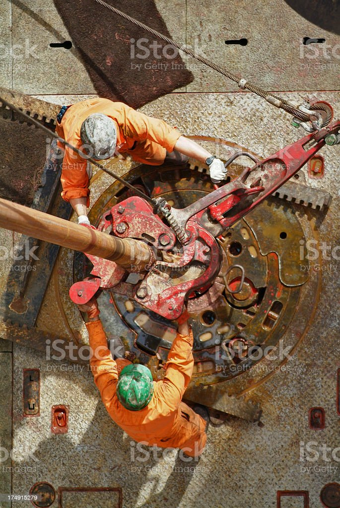 Two drilling operators working on an oil rig. stock photo