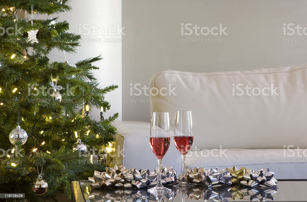 two drinks and bows by christmas tree royalty-free stock photo