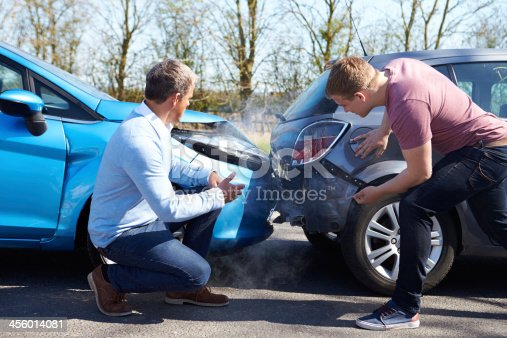 istock Two Drivers Arguing After Traffic Accident 456014081