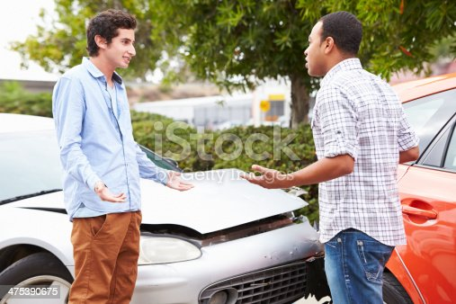 475395935istockphoto Two Drivers Arguing After Traffic Accident 475390675