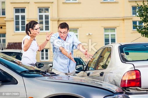 475395935istockphoto Two Drivers Arguing After Traffic Accident 516912593