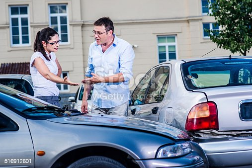 475395935istockphoto Two Drivers Arguing After Traffic Accident 516912601
