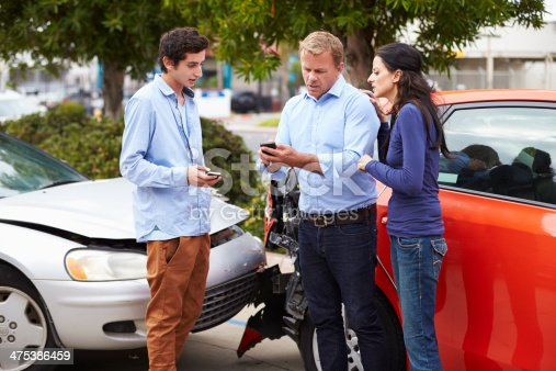 475395935istockphoto Two Drivers Exchange Insurance Details After Accident 475386459