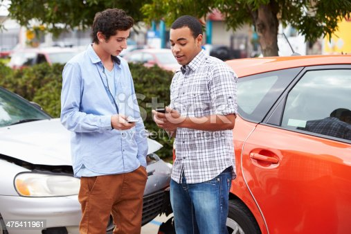 475395935istockphoto Two Drivers Exchange Insurance Details After Accident 475411961