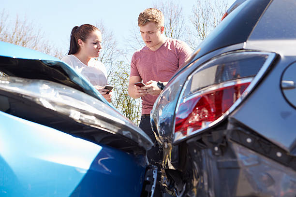 two drivers exchanging information after accident - impaired driving stock photos and pictures