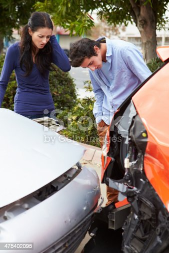 475395935istockphoto Two Drivers Inspecting Damage After Traffic Accident 475402095
