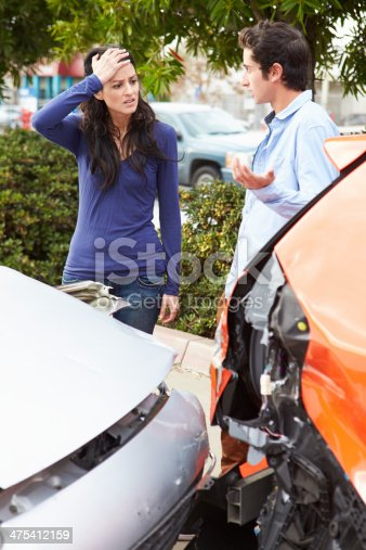 475395935istockphoto Two Drivers Inspecting Damage After Traffic Accident 475412159