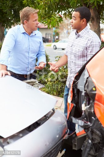 475395935istockphoto Two Drivers Inspecting Damage After Traffic Accident 475412175