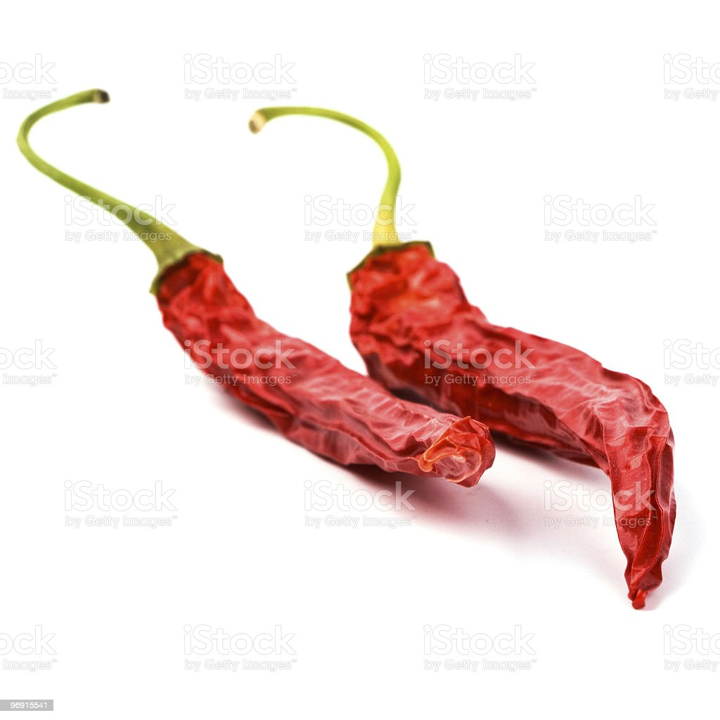 two dry red chili peppers royalty-free stock photo