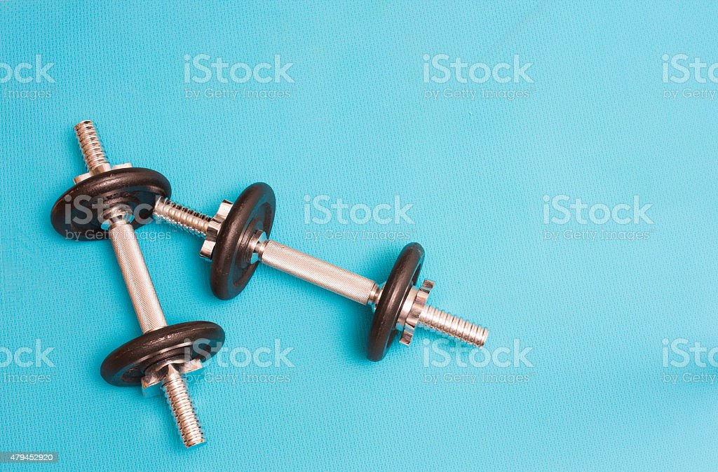 Two dumbbellls resting stock photo