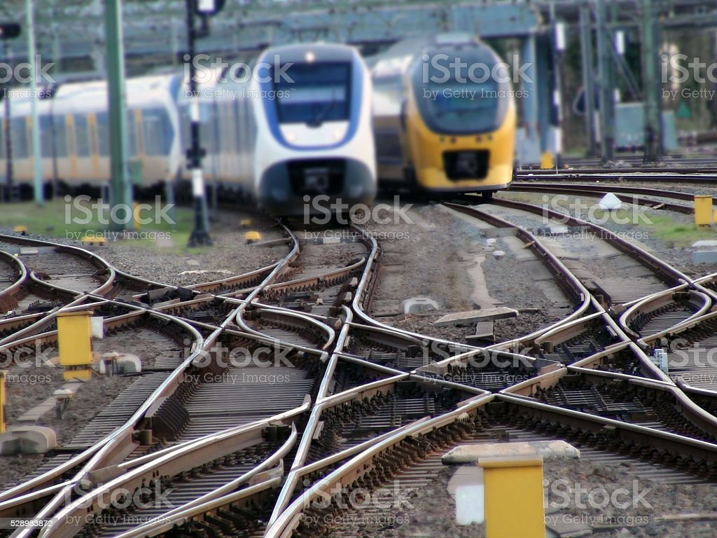 Two Dutch Passenger Train Riding On Railroad Track In Netherlands.Europe stock photo