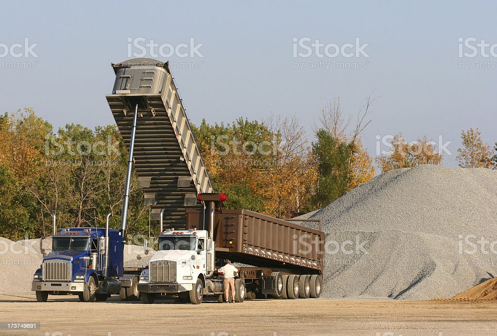Two Earth Mover Trucks royalty-free stock photo