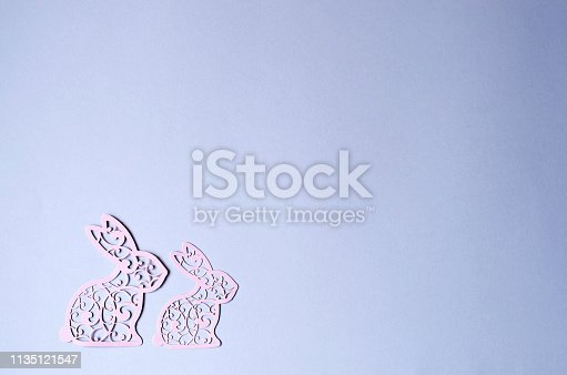 istock Two Easter bunny cut out of pink paper. 1135121547