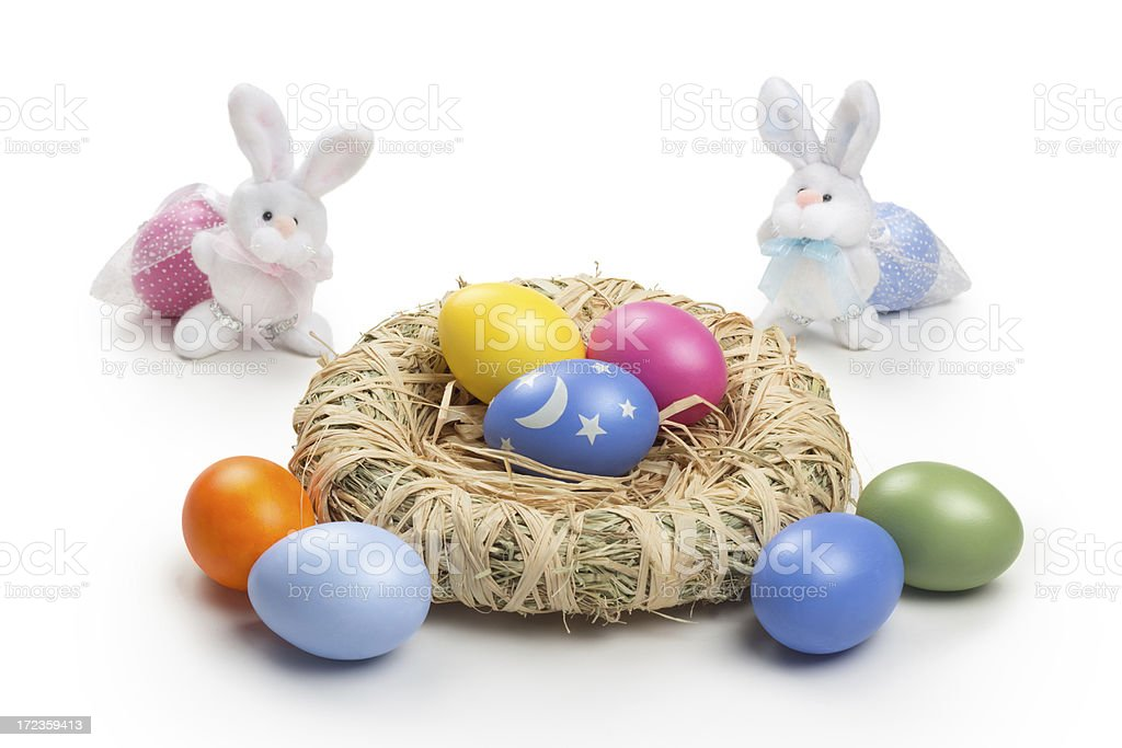 Two easter bunnys carrying eggs royalty-free stock photo
