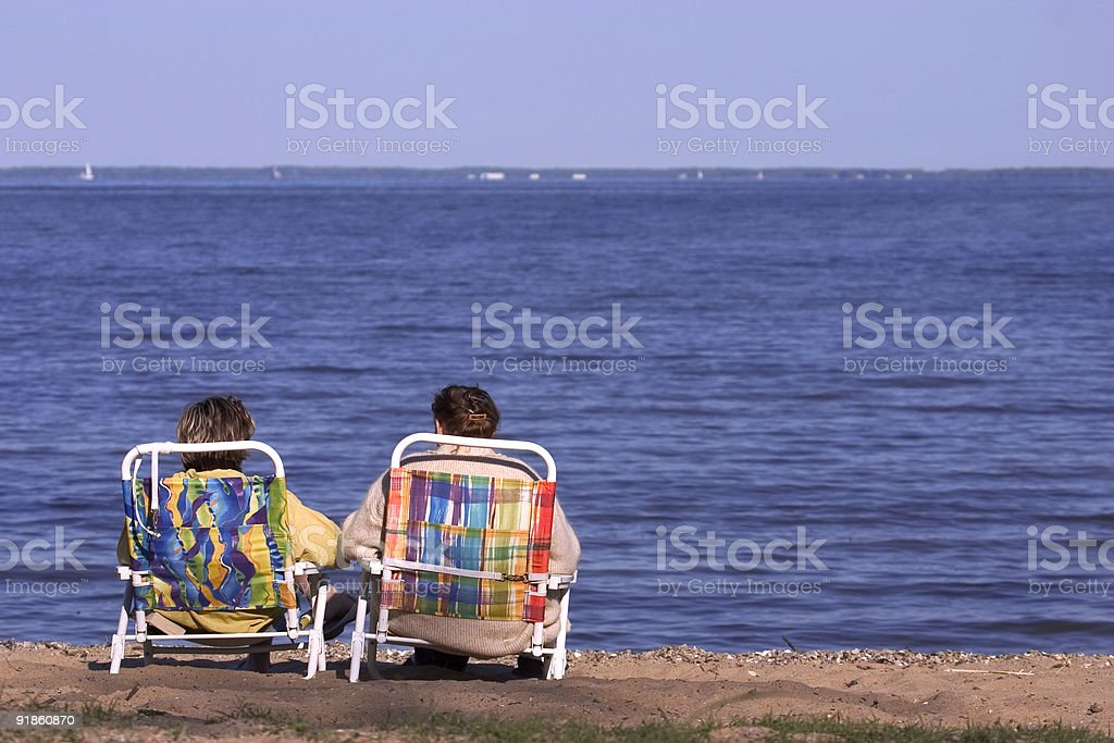 two easy chairs on beach royalty-free stock photo