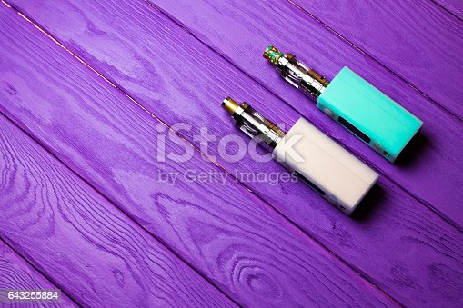 864217444 istock photo two e-cigarette (electronic cigarette, vape) on the wood background 643255884