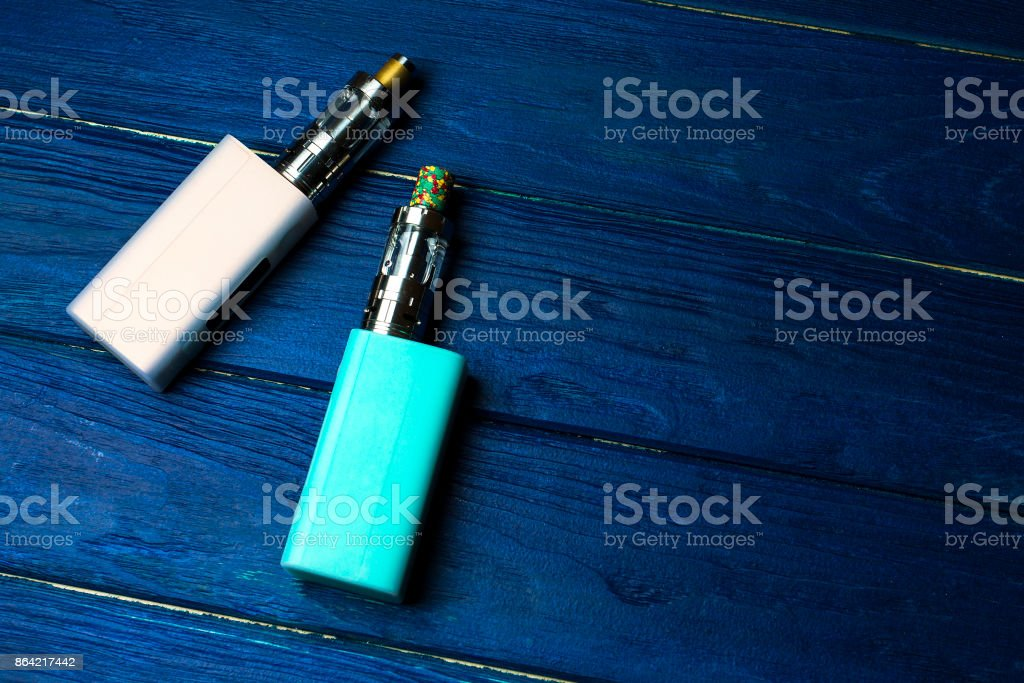 two e-cigarette (electronic cigarette, vape) on the wood background royalty-free stock photo