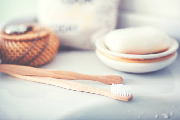Two eco-friendly wooden toothbrushes in the bathroom stock photo